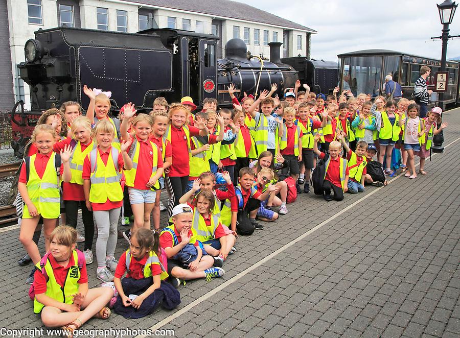 Primary school children group educational visit  heritage railway, Porthmadog, Gwynedd, north west Wales, UK