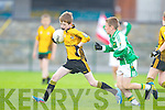 Tadhg O'Carroll of Ballydonoghue races against Tim Scannlon of Listowel Emmetts in the Tim Kennelly League last Sunday in Listowel.