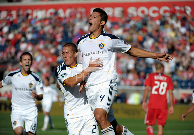 LA Galaxy defender Omar Gonzalez (4) celebrates with teammate Bryan Jordan (27) after scoring the game tying goal in the 90th minute.  The LA Galaxy tied the Chicago Fire 1-1 at Toyota Park in Bridgeview, IL on September 4, 2010