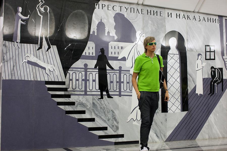 """Moscow, Russia, 20/06/2010..Scenes in the newly opened Dostoevsky metro station, the newest station in the Moscow metro underground transport system. The station opening was delayed both because of construction problems and because of concerns that the gloomy murals of scenes from the writer's work would, in the words of one psychiatrist, make the station a """"mecca for suicides""""."""