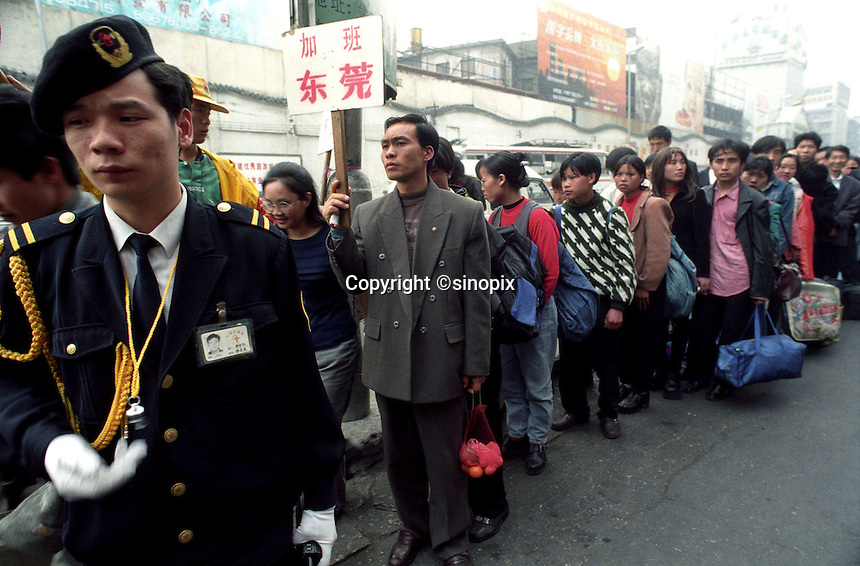 Officials direct a group of migrants newly     arrived from northern China outside Guangzhou railway station. Some 200,000 migrants pass through the station daily..06-MAR-99