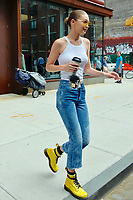 www.acepixs.com<br /> <br /> June 26 2017, New York City<br /> <br /> Model Gigi Hadid wears matching yellow Doc Marten boots and sunglasses as she leaves her East Village apartment on June 26 2017 in New York City<br /> <br /> By Line: Curtis Means/ACE Pictures<br /> <br /> <br /> ACE Pictures Inc<br /> Tel: 6467670430<br /> Email: info@acepixs.com<br /> www.acepixs.com