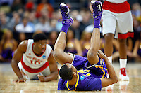 PITTSBURGH, PA - MARCH 19:  Tim Quarterman #55 of the LSU Tigers falls to the ground after fighting for the ball against Lennard Freeman #10 of the North Carolina State Wolfpack in the first half during the second round of the 2015 NCAA Men's Basketball Tournament at Consol Energy Center on March 19, 2015 in Pittsburgh, Pennsylvania.  (Photo by Jared Wickerham/Getty Images)
