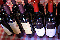 Several different bottles of Pisano wines on the tasting table. Bodega Pisano Winery, Progreso, Uruguay, South America
