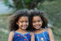 Twin girls enjoy summer fun.