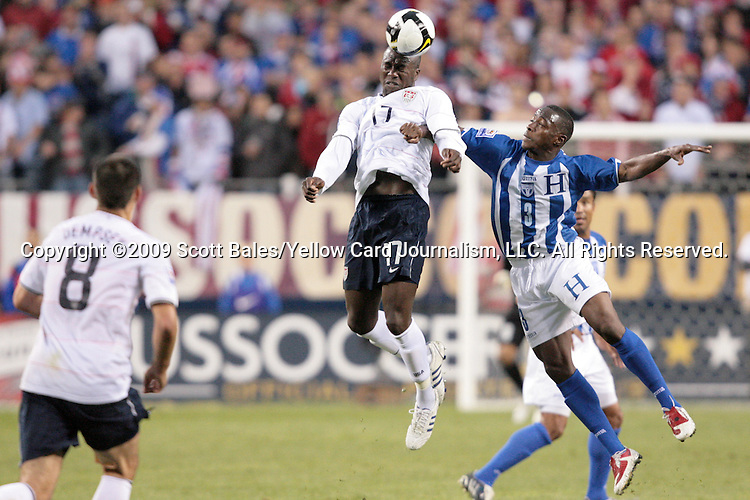 06 June 2009: Jozy Altidore (USA) (17) heads the ball over Maynor Figueroa (HON) (3). The United States Men's National Team defeated the Honduras Men's National Team 2-1 at Soldier Field in Chicago, Illinois in the Hexagonal, the final CONCACAF round, a FIFA 2010 South Africa World Cup Qualifier.