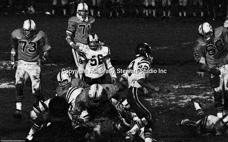 Bethel Park PA:  Defensive play with Mike Stewart 11 and Clark Miller 30 making the tackel on a Mt Lebanon running back.  Others in the photo; Jim Dingeldine 73, Glenn Eisaman 71, Dennis Franks 66.  The defense recovered 5 fumbles but the offense was not able to score against the Mt Lebanon Defense.  The field conditions were herendous, after every play you had to get the saw dust out of your eyes. After a highly disputed non-TD call  by Art Walker's brother in law, the undefeated Mt Lebanon Blue Devils  ended up winning the Western Conference.  The defensive unit was one of the best in Bethel Park history only allowing a little over 7 points a game.