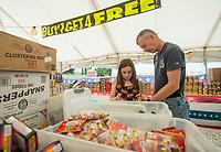NWA Democrat-Gazette/BEN GOFF @NWABENGOFF<br /> Savannah Sturdivant and father John Sturdivant of Centerton shop for fireworks Saturday, June 30, 2018, at Fireworks City in Benton County near Centerton.