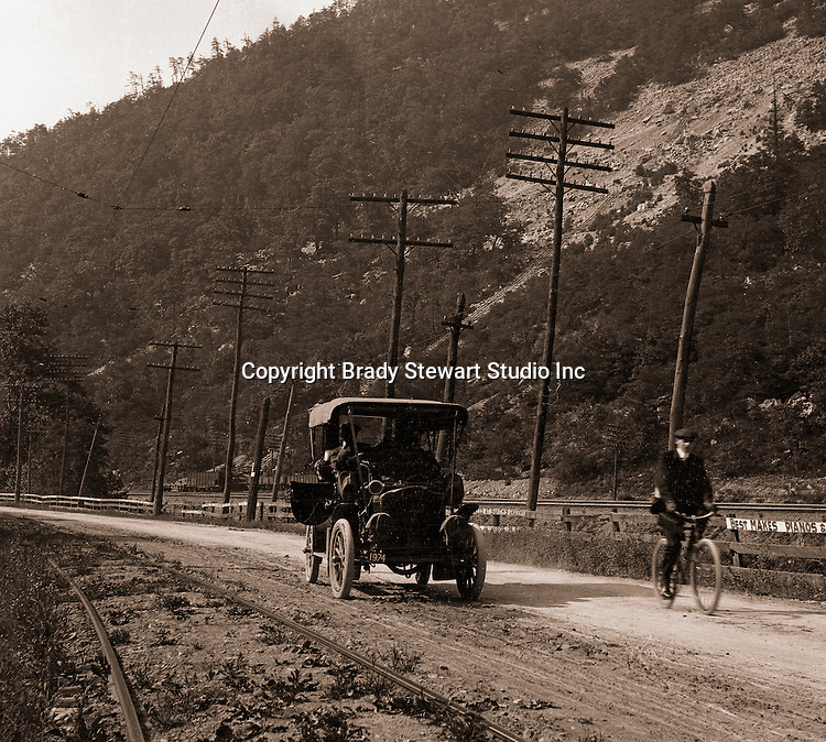 East McKeesport PA:  Brady Stewart's new 1906 Buick Model F driving along the railroad tracks - 1906