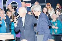 Democratic presidential candidate and former Vice President Joe Biden thanks former Secretary of State John Kerry as he takes to the stage at a campaign event at The Sports Barn in Hampton, New Hampshire, on Sun., December 8, 2019.