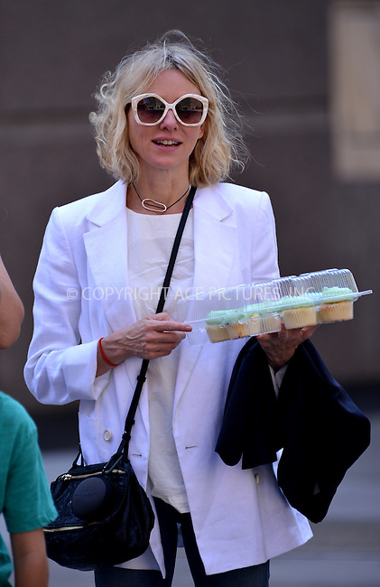 www.acepixs.com<br /> <br /> June 24 2016, New York City<br /> <br /> Actress Naomi Watts carries a tray of cakes as she walks in Tribeca on June 24 2016 in New York City<br /> <br /> By Line: Curtis Means/ACE Pictures<br /> <br /> <br /> ACE Pictures Inc<br /> Tel: 6467670430<br /> Email: info@acepixs.com<br /> www.acepixs.com