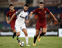 Calcio, Serie A: Roma, stadio Olimpico, 26 agosto, 2017.<br /> Inter's Antonio Candreva (l) in action with Roma's Kevin Strootman (r) during the Italian Serie A football match between Roma and Inter at Rome's Olympic stadium, August 26, 2017.<br /> UPDATE IMAGES PRESS/Isabella Bonotto