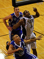 Wellington's Nick Horvath (back) and Lindsay Tait and Nelson's Michael Harrison watch the ball during the NBL Round 12 match between the Wellington Saints and Nelson Giants at TSB Bank Arena, Wellington, New Zealand on Thursday 15 May 2008. Photo: Dave Lintott / lintottphoto.co.nz