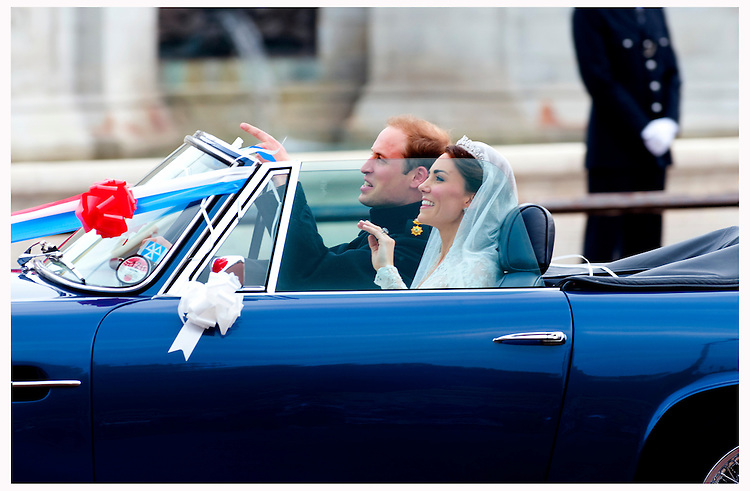 Prince William, Duke of Cambridge and Catherine, Duchess of Cambridge leave Buckingham Palace after their Wedding reception in Prince Charles' vintage Aston Martin DB6 Volante on April 29, 2011 in London, England. .Tel: 07515 876520.e mail: info@kisforkate.com
