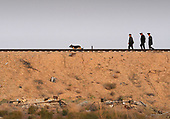 Russian security personnel walk the railroad line ahead of the Soyuz TMA-13 spacecraft as it is transported by railcar to its launch pad at the Baikonur Cosmodrome in Kazakhstan, Friday, Oct. 10, 2008 for launch Oct. 12 to carry Expedition 18 Commander Michael Fincke, Flight Engineer Yury V. Lonchakov and American Spaceflight Participant Richard Garriott to the International Space Station. The three crew members will dock their Soyuz to the International Space Station on Oct. 14. Fincke and Lonchakov will spend six months on the station, while Garriott will return to Earth Oct. 24, 2008 with two of the Expedition 17 crew members currently on the International Space Station. <br /> Mandatory Credit: Bill Ingalls / NASA via CNP