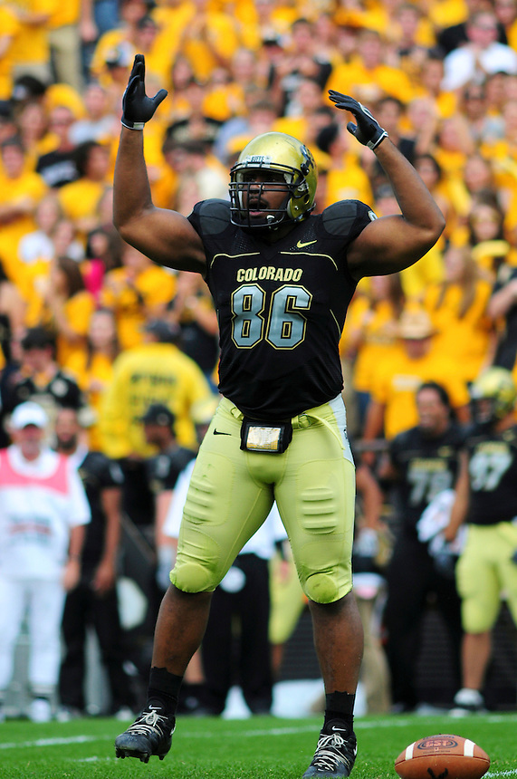 06 September 08: Colorado defensive tackle George Hypolite tries to rally the crowd during a game against Eastern Washington. The Colorado Buffaloes defeated the Eastern Washington Eagles 31-24 at Folsom Field in Boulder, Colorado. FOR EDITORIAL USE ONLY