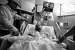 "Jimmy ""Stretch"" Borunda is comforted by friends while in the ICU in San Antonio, Texas. April 25, 2009."