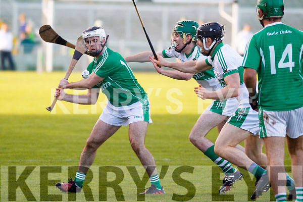 Ballyduff's Jack Goulding attempts to get a shot off as  Liam O'Keeffe Kanturk close him down, in the Munster IHC semi final in Austion Stack Park on Sunday last.