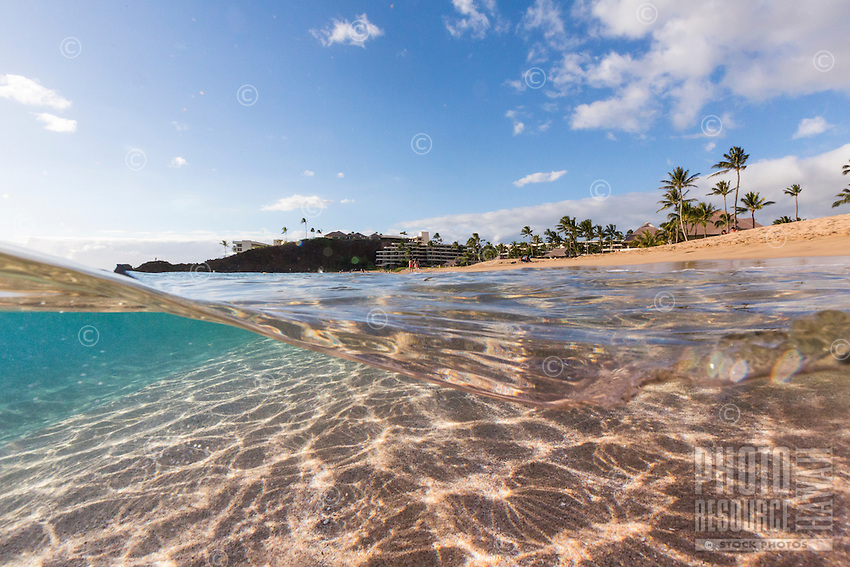 An over-and-under image of Ka'anapali Beach and Black Rock, Maui.