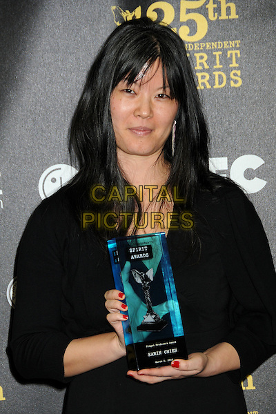 KARIN CHIEN .25th Annual Film Independent Spirit Awards - Press Room held at the Nokia Event Deck at L.A. Live, Los Angeles, California, USA, 5th March 2010..indie half length fringe black trophy award winner .CAP/ADM/BP.©Byron Purvis/AdMedia/Capital Pictures.