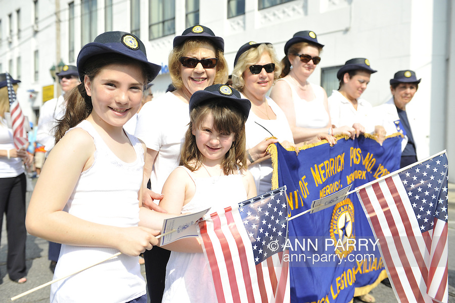 American Legion Merrick Post 1282 Auxiliary members - Sharon Williams & her granddaughters Madison & Jacqueline; Florence Hoffman, Betty Tucker... - marching in Merrick Memorial Day Parade on May 28, 2012, on Long Island, New York, USA. America's war heroes are honored on this National Holiday.