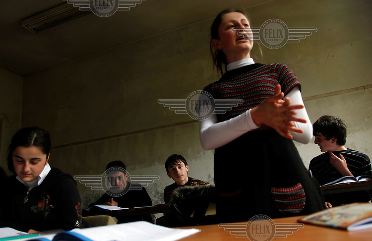 A girl stands up to speak in a class at a school in Keda.