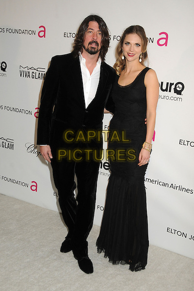 Dave Grohl (Foo Fighters) & Jordyn Blum Grohl.21st Annual Elton John Academy Awards Viewing Party held at West Hollywood Park, West Hollywood, California, USA..February 24th, 2013.oscars full  length suit black white suit shirt beard facial hair married husband wife dress gold bracelet .CAP/ADM/BP.©Byron Purvis/AdMedia/Capital Pictures.