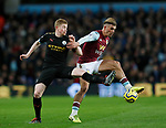 Kevin De Bruyne of Manchester City tackles Jack Grealish of Aston Villa  during the Premier League match at Villa Park, Birmingham. Picture date: 12th January 2020. Picture credit should read: Darren Staples/Sportimage