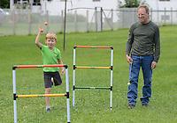FALLSINGTON, PA -  SEPTEMBER 14:  Charlie Bray (left), 6 years old, and Joe Zettock play a game at the Irish Festival September 14, 2013 in Fallsington, Pennsylvania. (Photo by William Thomas Cain/Cain Images)
