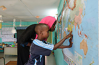 DJIBOUTI , Arta, school, children at world map / DSCHIBUTI, Arta, Schule, Kinder an einer Weltkarte