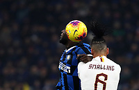 Calcio, Serie A: Inter Milano - AS Roma, Giuseppe Meazza stadium, December 6, 2019.<br /> Inter's Romelu Lukaku (l) in action with Roma's Chris Smalling (r) during the Italian Serie A football match between Inter and Roma at Giuseppe Meazza (San Siro) stadium, on December 6, 2019.<br /> UPDATE IMAGES PRESS/Isabella Bonotto