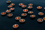 Floating candles on the Ganges River, Varanasi, Uttar Pradesh State, India