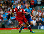 Liverpool's Roberto Firmino (L) in action with Arsenal's Laurent Koscielny during the premier league match at Anfield Stadium, Liverpool. Picture date 27th August 2017. Picture credit should read: Paul Thomas/Sportimage