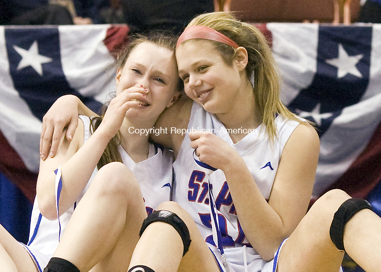 Uncasville, CT- 22 March 2014-032214CM14- St. Paul's Kelly McMahon, left, and Elizabeth Ferraro console one another after losing to Thomaston in the Class S State championship game at the Mohegan Sun Arena in Uncasville on Saturday.  Thomaston won, 61-57.   Christopher Massa Republican-American