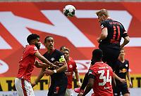 24th May 2020, Opel Arena, Mainz, Rhineland-Palatinate, Germany; Bundesliga football; Mainz 05 versus RB Leipzig; Jeremia St. Juste (FSV Mainz 05), Yussuf Poulsen (RB Leipzig), Ridle Baku (FSV Mainz 05) watch as Timo Werner (RB Leipzig) wins the header to score