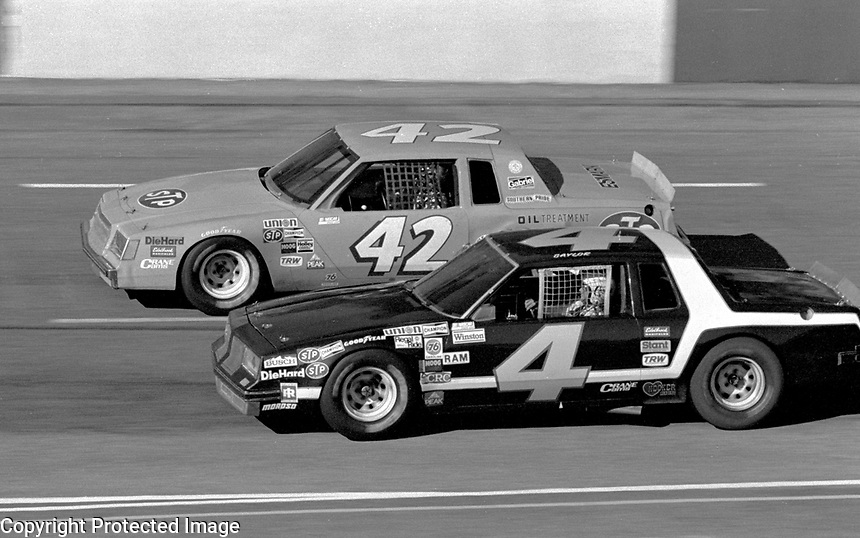 Connie Saylor and Kyle Petty race side by side into turn three at Atlanta in November 1981. (Photo by Brian Cleary)