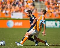 Los Angeles Galaxy midfielder Dema Kovalenko (8) tries to hold off Houston Dynamo midfielder Stuart Holden (22) . Houston Dynamo tied Los Angeles Galaxy 0-0 at Robertson Stadium in Houston, TX on October 18, 2009.
