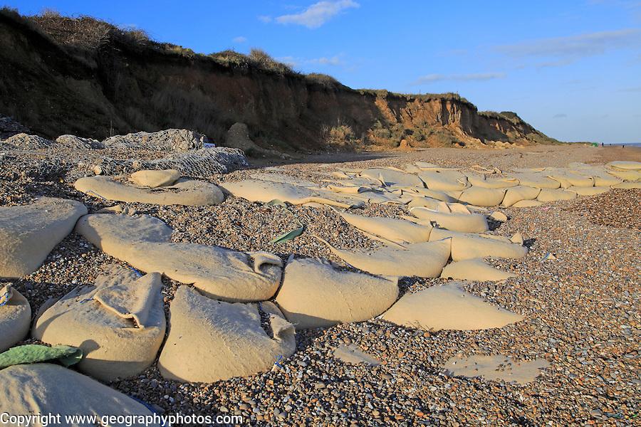 Sacks containing shingle form coastal defences at Thorpeness, Suffolk, England, UK
