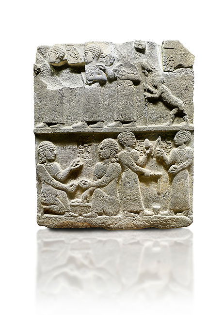 """Hittite monumental relief sculpted orthostat stone panel of Royal Buttress. Basalt, Karkamıs, (Kargamıs), Carchemish (Karkemish), 900 - 700 B.C. Anatolian Civilisations Museum, Ankara, Turkey.<br /> <br /> This panels scene showing 8 out of 10 children of the King, the hieroglyphs reads as follows: """"Malitispas, Astitarhunzas, Tamitispas,Isikaritispas, Sikaras, Halpawaris, Ya hilatispas"""". Above, there are three figures holding knucklebones (astragalus) and one figure walking by leaning on a stick; below are two each figures playing the knucklebones and turning whirligigs.  <br /> <br /> Against a white background."""