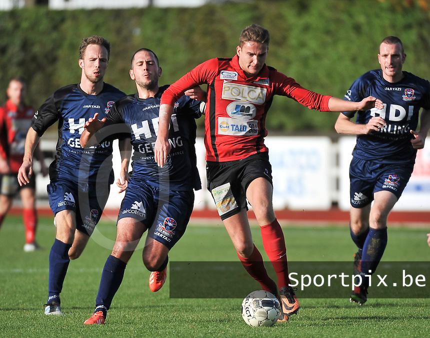 KFC Izegem - FC Dender  : Marijn Vandewalle aan de bal voor de opzittende Yanis Papassarantis (links)<br /> foto VDB / Bart Vandenbroucke