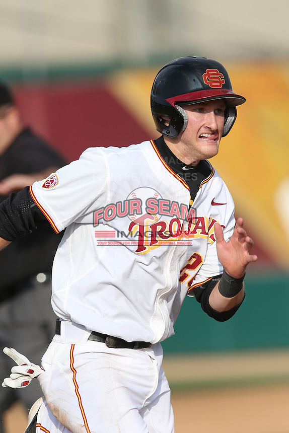 Blake Lacey (26) of the Southern California Trojans runs the bases during a game against the Oakland Grizzlies at Dedeaux Field on February 21, 2015 in Los Angeles, California. Southern California defeated Oakland, 11-1. (Larry Goren/Four Seam Images)