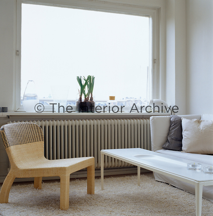The sitting area in the open-plan living area is simply furnished