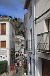 Tourists in streets of hilltop castle and village, El Castell de Guadalest, Alicante province, Spain