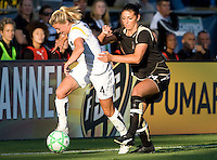 23 July 2009:  Aly Wagner of Los Angeles Sol dribbles the ball away from Greer Barnes of FC Gold Pride during the first half of the game at Buck Shaw Stadium in Santa Clara, California.   FC Gold Pride tied Los Angeles Sol, 0-0.