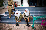 Sharia police return from praying at a mosque in Ulele, Indonesia, on Thursday, Nov. 11, 2009.