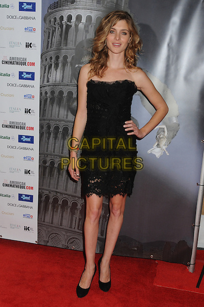 "Vittoria Puccini.Cinema Italian Style 2011 Opening Night Gala Screening of ""Terraferma"" held at Grauman's Egyptian Theatre, Hollywood, California, USA. .November 11th, 2011.full length dress hand on hip black strapless .CAP/ADM/BP.©Byron Purvis/AdMedia/Capital Pictures."