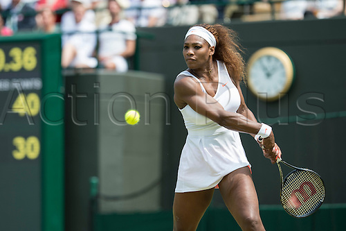 27.06.2013. The Wimbledon Tennis Championships 2013 held at The All England Lawn Tennis and Croquet Club, London, England, UK.  <br /> <br /> Serena Williams (USA) [1] (in orange shorts) v Caroline Garcia (FRA) on No 1 Court.