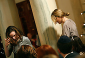 Washington, DC - December 15, 2008 -- President's daughters Barbara Bush, left, and Jenna Hager, right, arrive at the Hanukkah Reception in the Grand Foyer of the White House, Washington DC, Monday, December 15, 2008..Credit: Aude Guerrucci / Pool via CNP