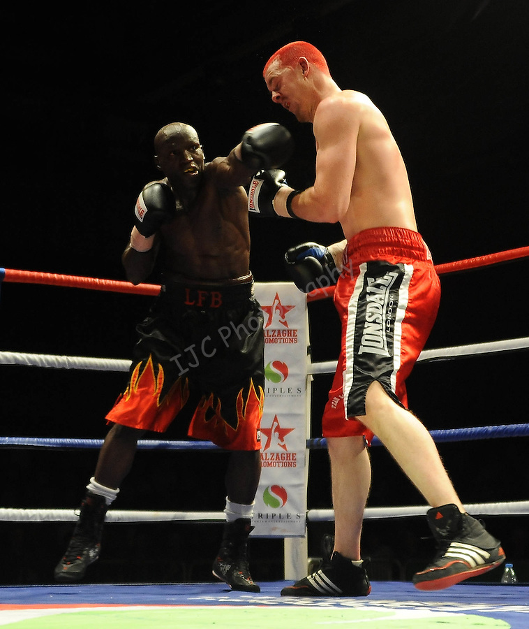 Hari Miles ( Red with Black stripe ) V Nick Okoth (Black flame shorts) Joe Calzaghe Promotions Boxing Evening .Date: Friday 20/11/2009,  .© Ian Cook IJC Photography, 07599826381, iancook@ijcphotography.co.uk,  www.ijcphotography.co.uk, .