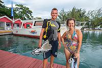 Honduras, Roatan Island, Fantasy Island Resort, Caribbean. Robin & Carolina scuba dive masters at Fantasy Island dive boats.